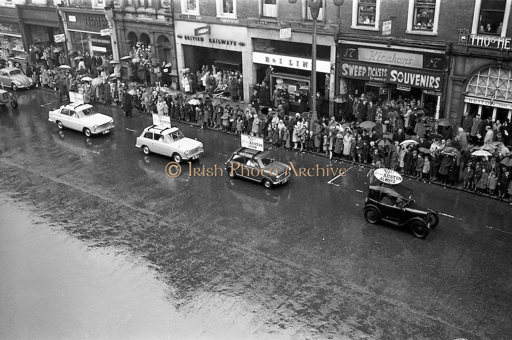 17/03/1963<br /> 03/17/1963<br /> 17 March 1963<br /> A selection of Austin cars, including a A7, A40 and a A60, in the N.A.I.D.A. St. Patricks Day Parade, passes down  Westmoreland Street. Dublin.