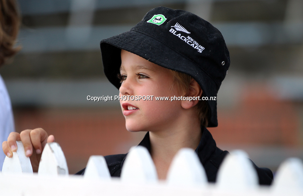 A young fan watches play on Day 3 of the 2nd test match.  New Zealand Black Caps v Pakistan, Test Match Cricket. Basin Reserve, Wellington, New Zealand. Monday 17 January 2011. Photo: Andrew Cornaga/photosport.co.nz