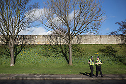 Liberal Democrat York Spring Conference , Day 1. Friday, 7th March 2014.  York , UK . Police in front of the City Walls opposite the Barbican Centre in York , ahead of the conference . The first day of the Liberal Democrat Spring Conference . Picture by Joel Goodman/i-Images