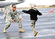 Staff Sgt. Steven Alvarez, of New Britain, is greeted by his son Gabriel, 4, as members of the Connecticut Army National Guard's 1st Battalion, 102nd Infantry and F company, 186th Brigade Support Battalion return Wednesday, November 17, 2010 to the guard's Army Aviation Support Facility at Bradley Airport in Windsor Locks. The units spent the last year in Afghanistan.  (Sean D. Elliot/The Day)