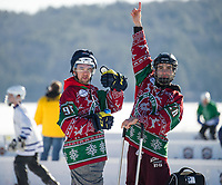 Mounted Reindeer team mates Sean McKeon and Craig Martin have been participating in the New England Pond Hockey Classic since the beginning as they get ready for their game against the Ballard House Inn Bulldogs in the Twig division on Friday.  (Karen Bobotas/for the Laconia Daily Sun)