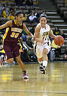 February 18, 2010: Iowa center Trisha Nesbitt (11) tries to drive past Minnesota guard Kiara Buford (30) during the second half of the NCAA women's basketball game at Carver-Hawkeye Arena in Iowa City, Iowa on February 18, 2010. Iowa defeated Minnesota 75-54.