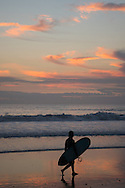 Pink clouds and a surfer looking out over the Santa Monica Bay at sunset. Santa Monica, CA 1.9.15