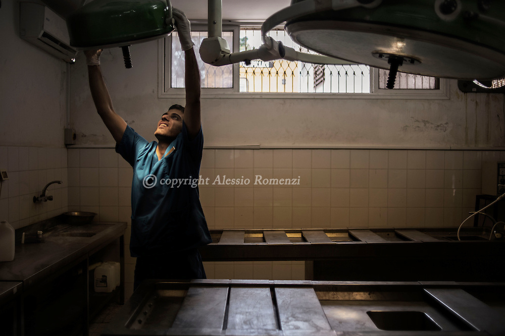 Gaza Strip, Gaza Strip: A mortician prepares the lights in Al Shifa hospital morgue on August 8, 2012. ALESSIO ROMENZI