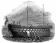 Prison Hulks: Convict hulk 'Warrior' at Woolwich. This hulk held 600 and was an intermediate confinement between an ordinary gaol or transportation.  Prisoners were used as labourers in the naval dockyards Hulks (Tenders) were usually old naval vessels that were no longer seaworthy. From 'The Illustrated London News', 1848.  Wood engraving