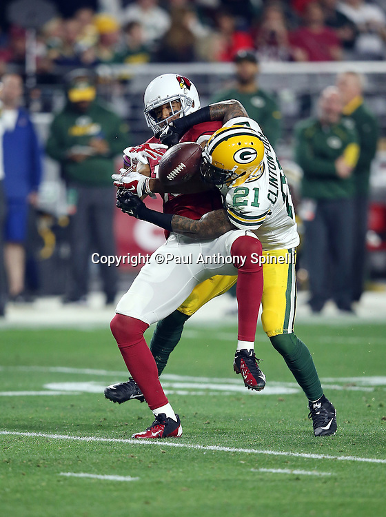 Arizona Cardinals wide receiver Michael Floyd (15) tries to catch a late second quarter pass broken up by Green Bay Packers free safety Ha Ha Clinton-Dix (21) during the NFL NFC Divisional round playoff football game against the Green Bay Packers on Saturday, Jan. 16, 2016 in Glendale, Ariz. The Cardinals won the game in overtime 26-20. (©Paul Anthony Spinelli)