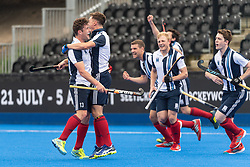 Hampstead & Westminster's Matt Guise-Brown celebrate scoring. Wimbledon v Hampstead & Westminster - Men's Hockey League Finals, Lee Valley Hockey & Tennis Centre, London, UK on 28 April 2018. Photo: Simon Parker