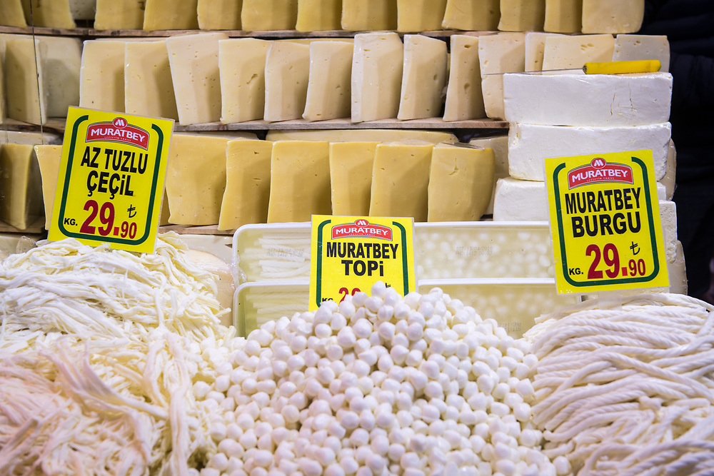 Different types of cheeses on display for sale at Istanbul Spice bazaar in Turkey