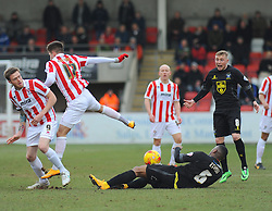 Bury's Kelvin Etuhu loses possession to Cheltenham Town's Zack Kotwica- Photo mandatory by-line: Nizaam Jones - Mobile: 07966 386802 - 14/02/2015 - SPORT - Football - Cheltenham - Whaddon Road - Cheltenham Town v Bury - Sky Bet League Two
