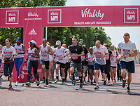 Lord Sebastian Coe leads The Olympians away from the start line ahead of their wave at The Vitality Westminster Mile, Sunday 28th May 2017.<br /> <br /> Photo: Neil Turner for The Vitality Westminster Mile<br /> <br /> For further information: media@londonmarathonevents.co.uk