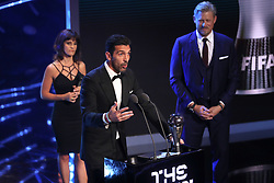 Gianluigi Buffon accepts the award for Best FIFA goalkeeper from Peter Schmeichel (right) during the Best FIFA Football Awards 2017 at the Palladium Theatre, London.