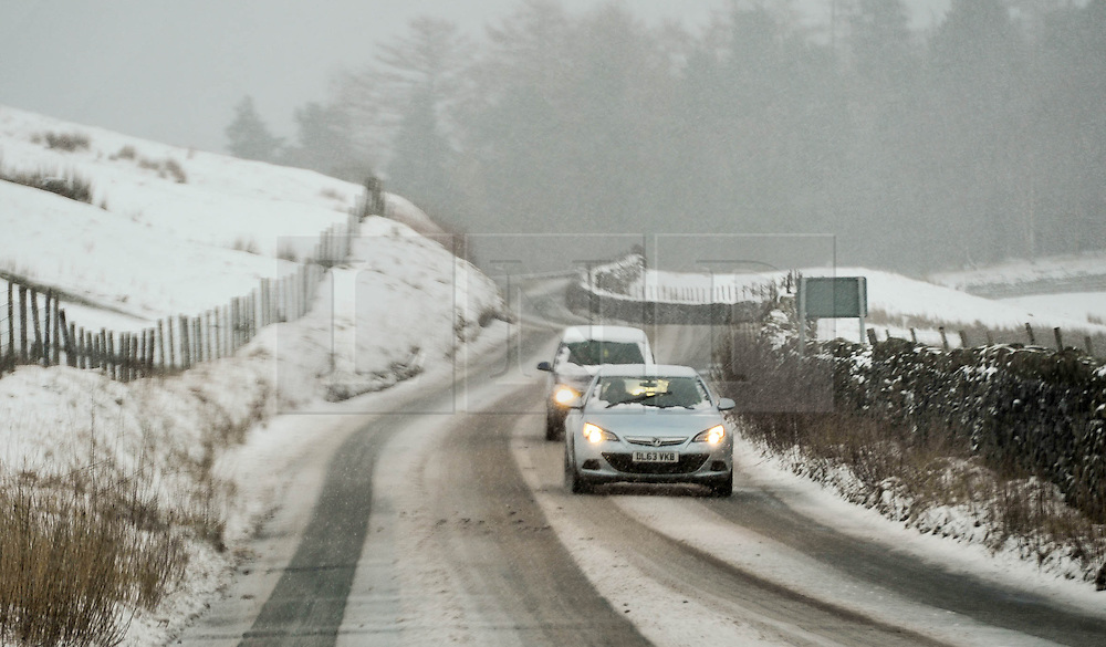 (c) Licenced to London News Pictures 29/01/2015. Cumbria, UK. Dangerous driving condition in the Lake District today 29th January 2015. Snow affects the higher fells in the Lake District. Photo credit : Harry Atkinson/LNP