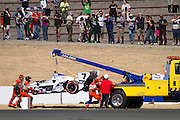 Sebastien Bourdais, #7, does not finish the race after a contact at the 1:26:42 mark damages his car during the GoPro Indy Grand Prix of Sonoma at Infineon Raceway in Sonoma, Calif., on Aug. 26, 2012.  Photo by Stan Olszewski/SOSKIphoto.