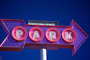 Blue sky day for purple and pink parking lot sign in Midtown, St. Louis photographed by Leandra Lewis.