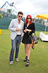 AMY MOLYNEAUX and PERCY PARKER at the 2011 Veuve Clicquot Gold Cup Final at Cowdray Park, Midhurst, West Sussex on 17th July 2011.