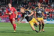 Cambridge United defender Mark Roberts clears ahead of York City forward, on loan from Oldham Athletic, Rhys Turner during the Sky Bet League 2 match between York City and Cambridge United at Bootham Crescent, York, England on 3 October 2015. Photo by Simon Davies.