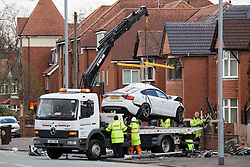 © Licensed to London News Pictures . 27/04/2016 . Manchester , UK . The Audi is lifted on to a vehicle carrier at the scene . Scene where police report two died in a fatal RTA involving a white Audi A5 at 03:15 this morning (Weds 27th April) . Greater Manchester Police report they observed the vehicle shortly before it crashed in to street furniture on Wilbraham Road in Chorlton, close to Whalley Range High School For Girls . Photo credit : Joel Goodman/LNP