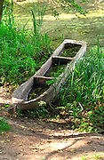 Carved wooden boat in a 2500 year old reconstructed ancient Slavic settlement.  Biskupin Poland