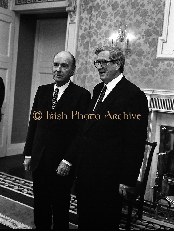 President Hillery Dissolves The Dáil. (R48)..1987..21.01.1987..01.21.1987..21st January 1987..At the request of An Taoiseach,Dr Garret Fitzgerald, President Patrick Hillery signed the Instrument of Dissolution to dissolve the Dáil and thus set in motion the general election...Picture shows An Taoiseach, Dr Garret Fitzgerald and President Patrick Hillery in Áras an Uachtaráin for the signing of the instrument of dissolution.