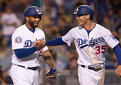 June 12, 2018 - Los Angeles, CA, U.S. - LOS ANGELES, CA - JUNE 12: Los Angeles Dodgers left fielder Matt Kemp (27) and Los Angeles Dodgers first baseman Cody Bellinger (35) celebrate after scoring in the forth inning during the game between the Texas Rangers and the Los Angeles Dodgers on June 12, 2018, at Dodger Stadium in Los Angeles, CA. (Photo by David Dennis/Icon Sportswire) (Credit Image: © David Dennis/Icon SMI via ZUMA Press)