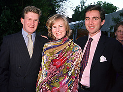 Left to right, the HON.PEREGRINE HOOD, MISS ALANNAH WESTON and <br /> S.D.PRINCE HEINRICH SAYN-WITTGENSTEIN-SAYN, at a dinner in London on 22nd May 2000.OEK 7