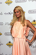 "Paris Hilton arrives on the red carpet at ""A Stellar Night"" hosted by ""Starlight Children's Foundation"" who are brightening the lives of seriously and terminally ill children in order to take their minds off the pain, fear and isolation of their illness. The Gala benefit was held at the Century Plaza Hyatt Hotel in Century City Ca. Saturday March 26, 2011. Photo by Peter Switzer"