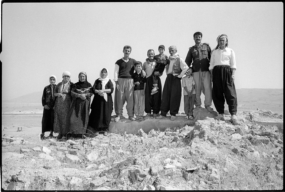 The Kurdish villagers of Kandaryarimja, a tiny village outside Erbil, Iraq, pose proudly at the edge of the remains of their village. A small number have recently returned, to rebuild the village after its destruction under Saddam Hussein's regime. There is no water (the pump is missing), and nothing but worn rubble remains of the old houses.