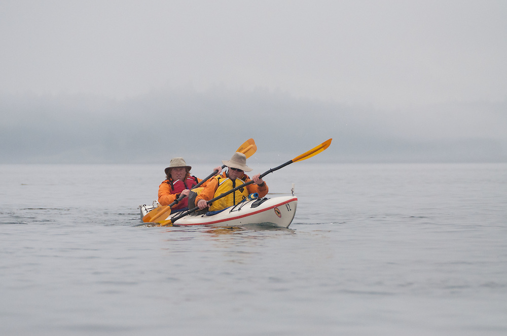 Nick and Brian Paddle Out of Reid Harbor, Stuart Island, Washington, US
