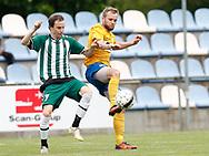 FODBOLD: Rasmus Lander (Ølstykke FC) presses af Brede-spiller under kampen i Serie 1 mellem Ølstykke FC og Brede IF den 3. juni 2017 på Ølstykke Stadion. Foto: Claus Birch