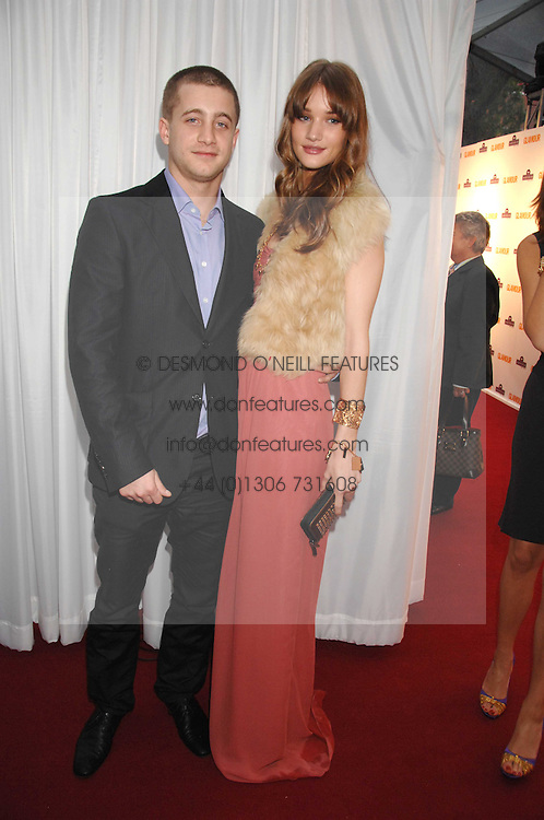 TYRONE WOOD and ROSIE HUNTINGTON-WHITELEY at the 2008 Glamour Women of the Year Awards 2008 held in the Berkeley Square Gardens, London on 3rd June 2008.<br />