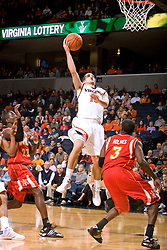 Virginia guard Sammy Zeglinski (13) shoots a hook shot over Virginia Military guard Chavis Holmes (3).The Virginia Cavaliers defeated the Virginia Military Institute Keydets 107-97 in NCAA Basketball at the John Paul Jones Arena on the Grounds of the University of Virginia in Charlottesville, VA on November 16, 2008.