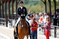 ROTHENBERGER Sönke (GER), Cosmo, ROTHENBERGER Gonnelien, ROTHENBERGER Sven, THEODORESU Monica (Bundestrainerin Dressur), HILBERATH Jonny (Co-Bundestrainer)<br /> Tryon - FEI World Equestrian Games™ 2018<br /> Backgroundbilder vom Abreiteplatz<br /> Grand Prix de Dressage Teamwertung und Einzelqualifikation<br /> 13. September 2018<br /> © www.sportfotos-lafrentz.de/Sharon Vandeput