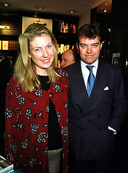 LORD & LADY PORCHESTER at a party in London on 14th September 1999.MWH 32