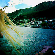 The wind blows a passengers hair on the TSS Earnslaw, the 100 year old vintage coal fired passenger steam ship which sails on Lake Wakatipu, Queenstown, New Zealand. The popular tourist attraction is celebrating it's centenary year with celebrations planned for October 2012.  Queenstown, Central Otago, New Zealand. 29th February 2012. Photo Tim Clayton