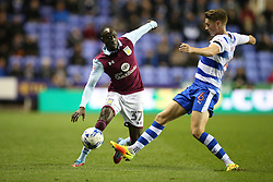 Albert Adomah of Aston Villa is tackled by George Evans of Reading - Mandatory by-line: Jason Brown/JMP - 18/10/2016 - FOOTBALL - Madejski Stadium - Reading, England - Reading v Aston Villa - Sky Bet Championship