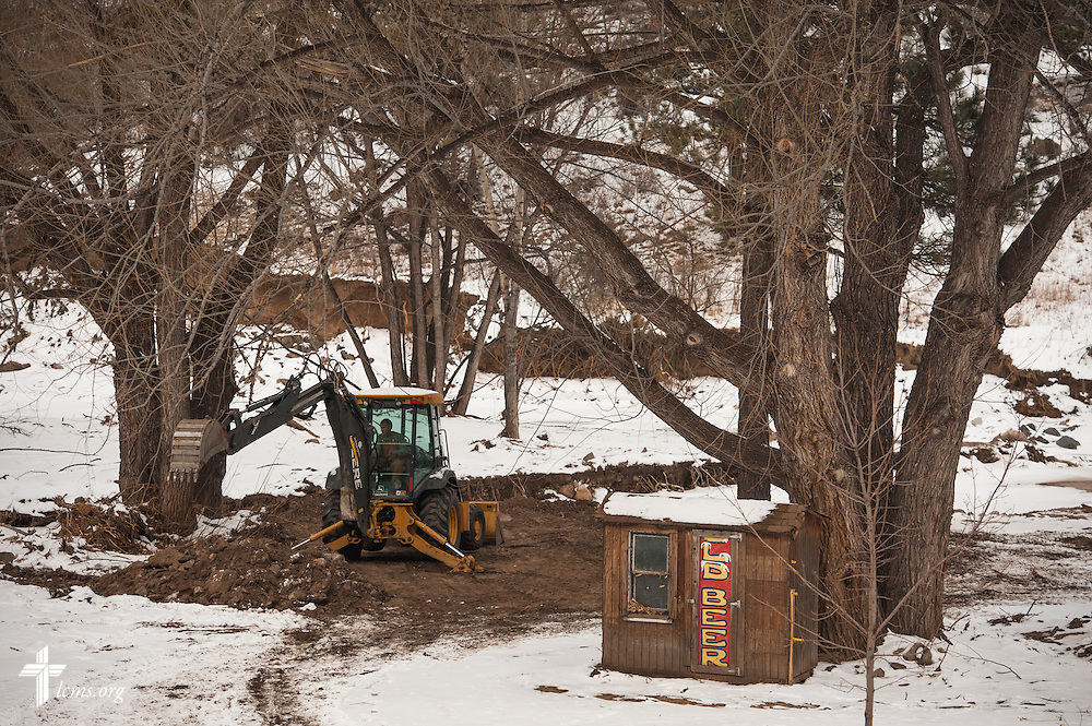 Jeff Shaffer uses a backhoe provided by the LCMS to help rebuild his campground damaged by September floods in Drake, Colo., on Tuesday, Jan. 7, 2014. LCMS Communications/Erik M. Lunsford