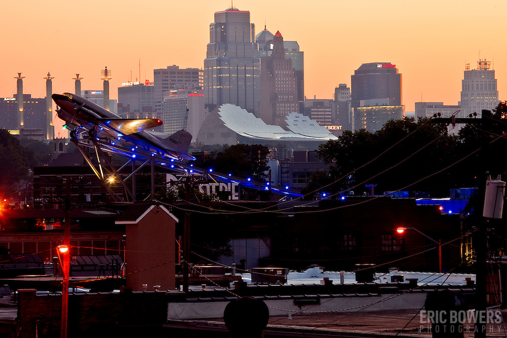 Roasterie Coffee Company's Douglas DC-3 airplane in front of the downtown Kansas City MO skyline at sunrise, summer 2013.