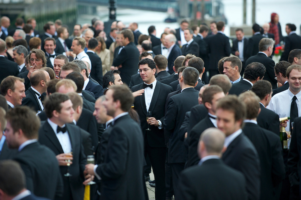 Crowd of people at a black tie event