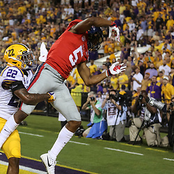 Sep 29, 2018; Baton Rouge, LA, USA; LSU Tigers cornerback Kristian Fulton (22) breaks up a pass to Mississippi Rebels wide receiver DaMarkus Lodge (5) during the first quarter of a game at Tiger Stadium. Mandatory Credit: Derick E. Hingle-USA TODAY Sports