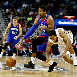 Nov 16, 2013; New Orleans, LA, USA; New Orleans Pelicans point guard Brian Roberts (22) and Philadelphia 76ers point guard Darius Morris (7) scramble for a loose ball during the first half of a game at New Orleans Arena. Mandatory Credit: Derick E. Hingle-USA TODAY Sports
