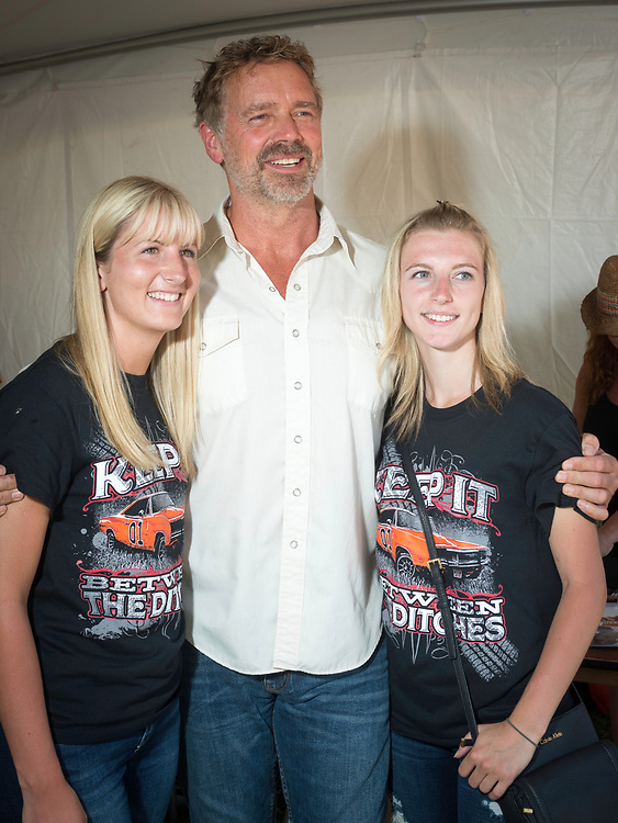 "July 30, 2017 - Luray, VA - John Schneider poses with friends Lindsay Lee and Brianna Schembri of Ontario, Canada. Scenes from ""Cooter's Last Stand,"" an event that reunites the cast of the television show ""The Dukes of Hazard,"" which celebrates Southern pride and hosted by Ben Jones. Photo by Susana Raab/Institute"