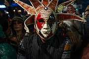 New York, NY - 31 October 2019. the annual Greenwich Village Halloween Parade along Manhattan's 6th Avenue. A reveler in an elaboraely gilt and filligreed jester mask.