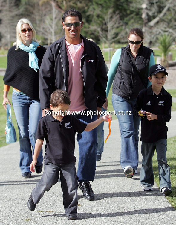 US Golf Open Champion Michael Campbell watches his 4yr old son Jordan during a visit to All Black training with his 6yr old son Thomas (R) and wife Julie (rear left) at Waitakere Stadium, Waitakere, Auckland, New Zealand on Thursday 28 July, 2005. Photo: Hannah Johnston/PHOTOSPORT<br />