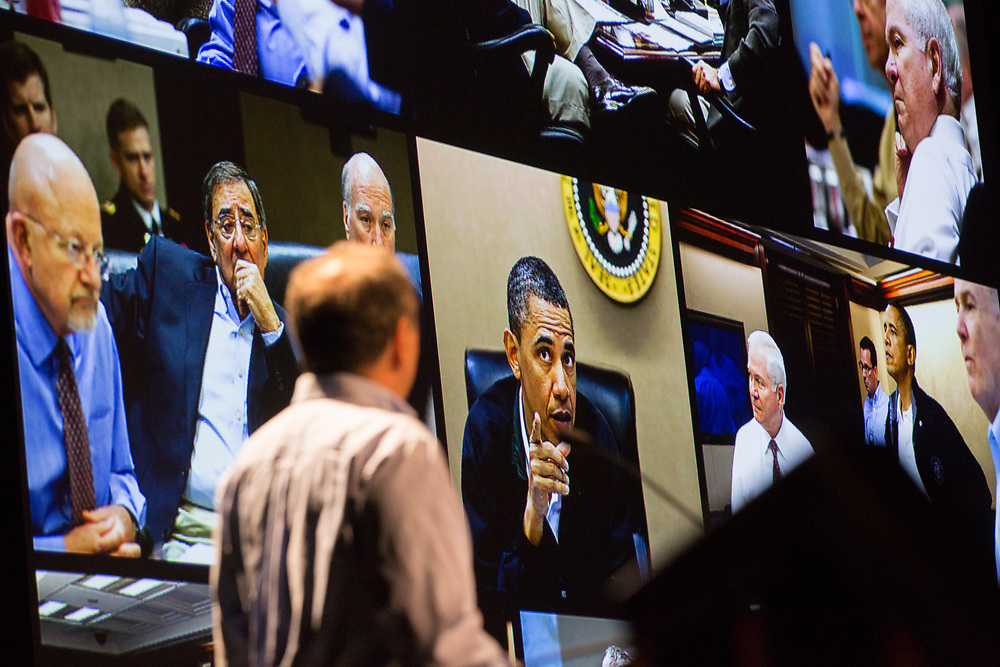 Pete Souza looks back at photos he took during Obama's presidency at his Kennedy Lecture on September 19, 2017.