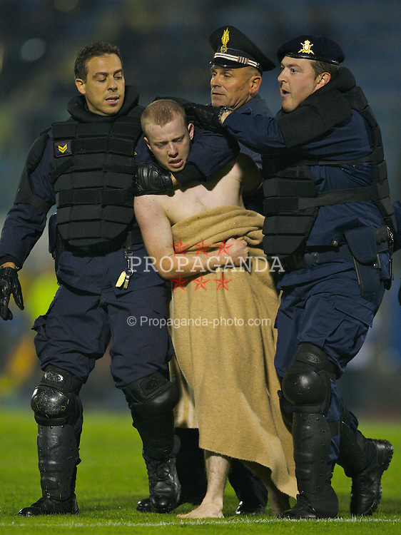 San Marino, San Marino - Wednesday, October 17, 2007: A Wales' streaker is escorted off the pitch by San Marino riot police during the Group D UEFA Euro 2008 Qualifying match at the Serravalle Stadium. (Photo by David Rawcliffe/Propaganda)