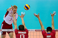 (L) Jakub Jarosz from Poland in action during the 2013 CEV VELUX Volleyball European Championship match between Poland v Slovakia at Ergo Arena in Gdansk on September 22, 2013.<br /> <br /> Poland, Gdansk, September 22, 2013<br /> <br /> Picture also available in RAW (NEF) or TIFF format on special request.<br /> <br /> For editorial use only. Any commercial or promotional use requires permission.<br /> <br /> Mandatory credit:<br /> Photo by © Adam Nurkiewicz / Mediasport