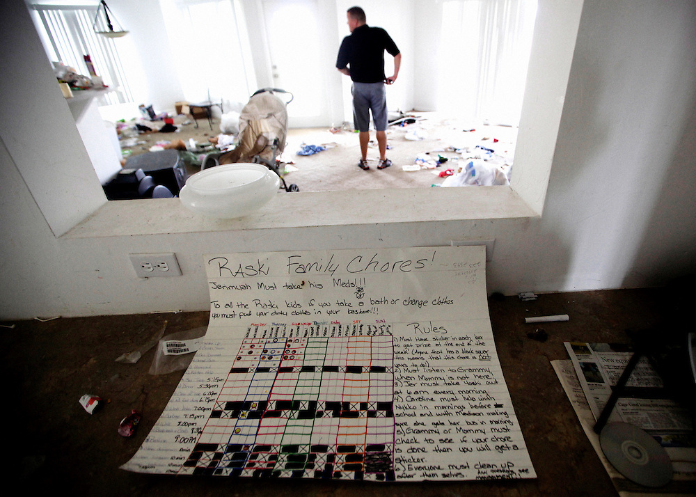 Signs of a family that once occupied a foreclosed home in Cape Coral are scattered about the now-abandoned property as Robbie Carney inspects it for an upcoming auction. Greg Kahn/Staff