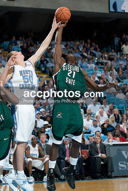 22 November 2005:  Tyler Hansbrough blocks #21 Patrick Tatham during a Cleveland State 55-112 loss at North Carolina in the Dean Smith Center in Chapel Hill, NC.