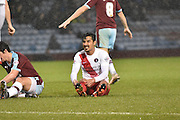 Burleys  Reza is tackled hard in the middle of the field during the Sky Bet Championship match between Burnley and Charlton Athletic at Turf Moor, Burnley, England on 19 December 2015. Photo by Mark Pollitt.