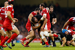 New Zealand Prop Charlie Faumuina is tackled by Georgia Flanker Mamuka Gorgodze (capt) - Mandatory byline: Rogan Thomson/JMP - 07966 386802 - 02/10/2015 - RUGBY UNION - Millennium Stadium - Cardiff, Wales - New Zealand v Georgia - Rugby World Cup 2015 Pool C.